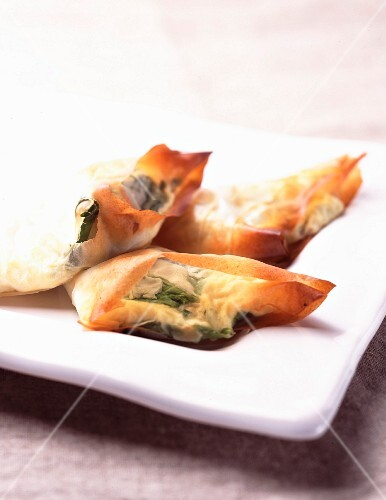 Spinach and cheese filo pastry triangles