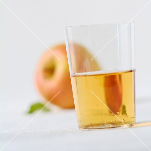 Glass of cider and apple