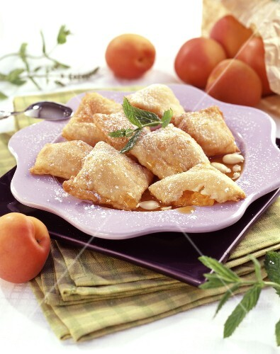 Fried ravioli with stewed apricot and fresh almonds