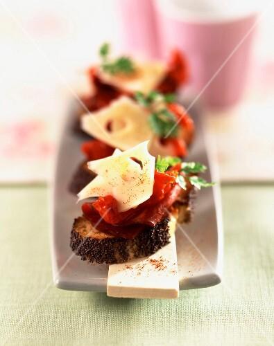 Crostini coppa ham with dried tomatoes and cheese