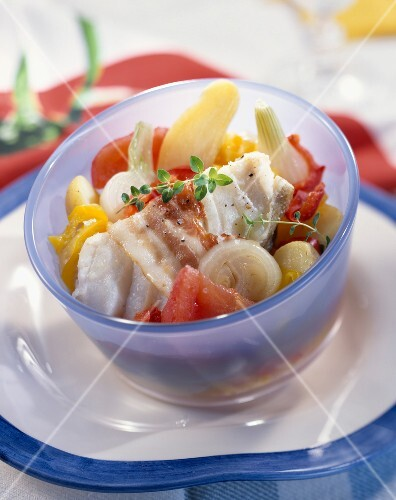 Hake, bacon, onion, tomato, potato and pepper salad