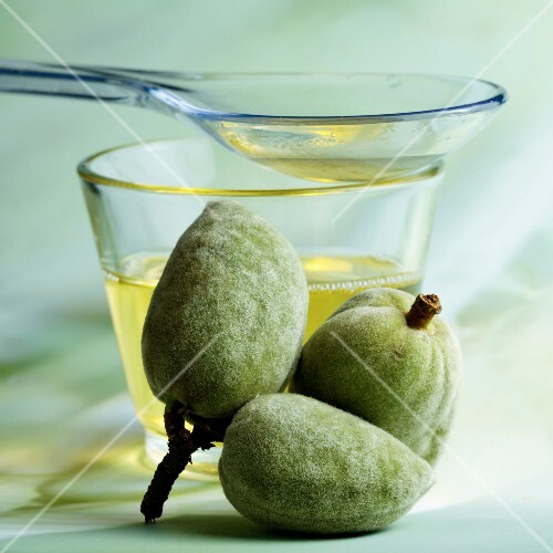 Fresh almonds and sweet almond oil