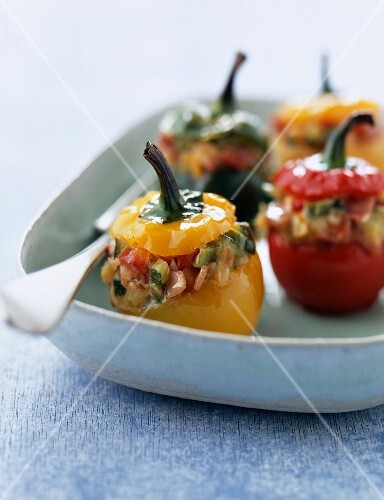Peppers stuffed with young vegetables, raw ham and ricotta