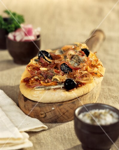 Pizza-style onion, anchovy and olive tart