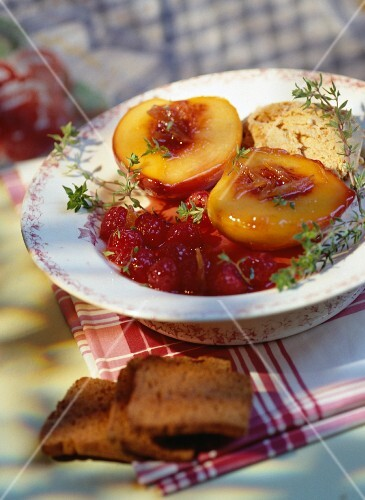 Poached peaches with raspberries
