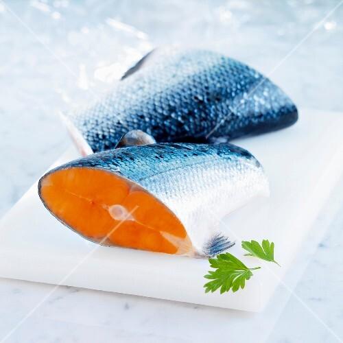 Salmon on white marble slab