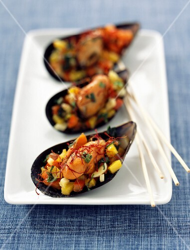 Mussels stuffed with yellow and red peppers and saffron