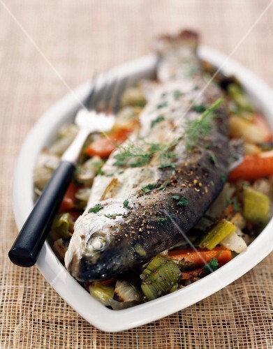 Trout cooked in the oven on a bed of fennel and capers