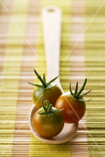 cherry tomatoes on a wooden spoon