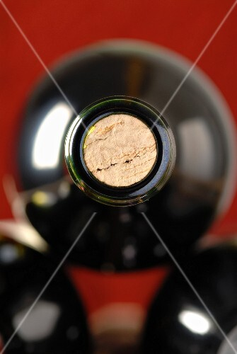 The neck and the cork of a bottle of wine