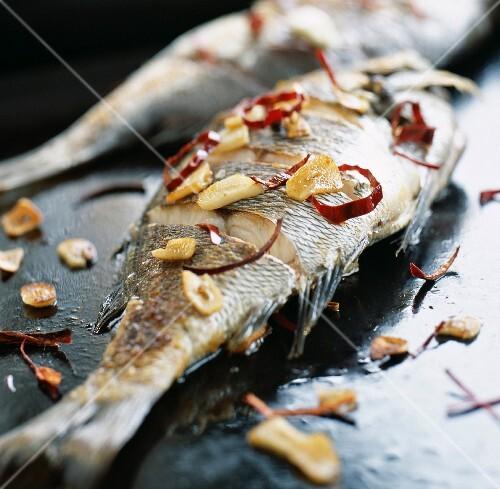 Grey sea bream with garlic a la plancha