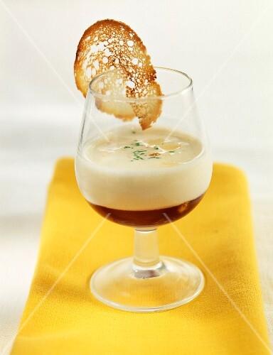 Verrine of white garlic cream with virgin malaga aspic