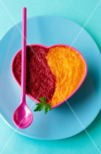pureed carrots and pureed beetroot with parsley
