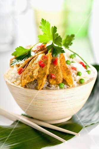 Bowl of rice with spicy chicken slivers