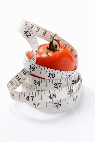 Diet tomato with measuring tape