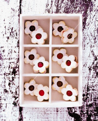 Flower-shaped jam biscuits in a seedling tray