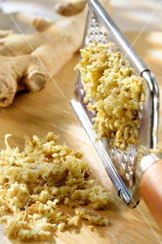 Grated ginger and a grater