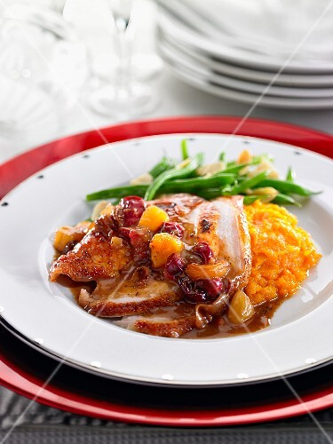 Fried chicken breast with mashed potatoes and braised summer fruits