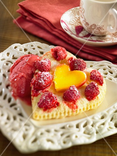 A heart-shaped Madeira cake with raspberries