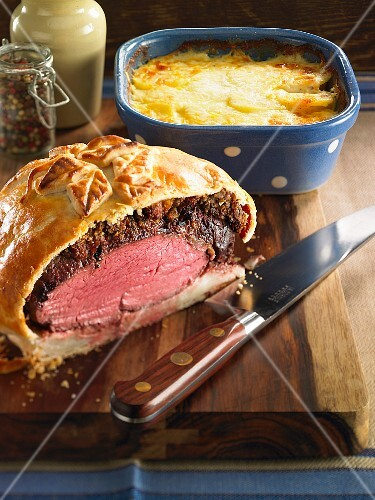 Beef wrapped in puff pastry with gratin dauphinois (traditional French potato gratin)