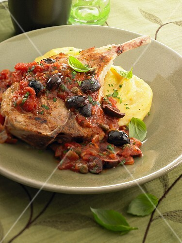 Lamb chop with tomato sauce and olives