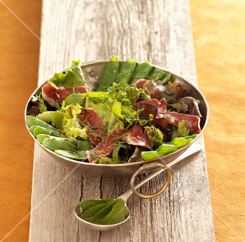 Mange tout salad with smoked duck breast