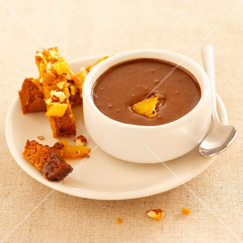 Chocolate soup with a slice of honey cake