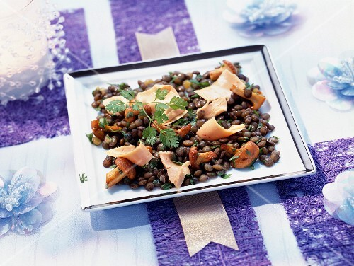 Warm lentil salad with truffle oil and strips of foie gras
