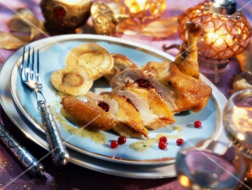 Capon with lingonberries and banana blinis