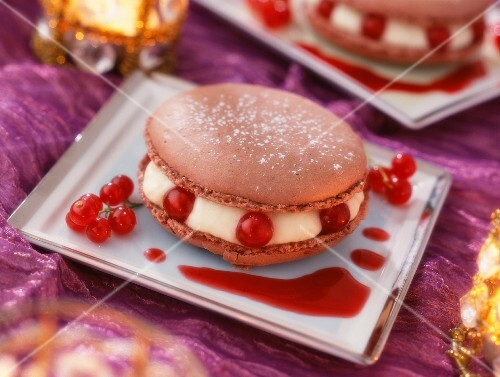 A chocolate macaroon with redcurrants