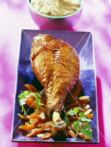 Roasted turkey leg and a carrot medley with almonds