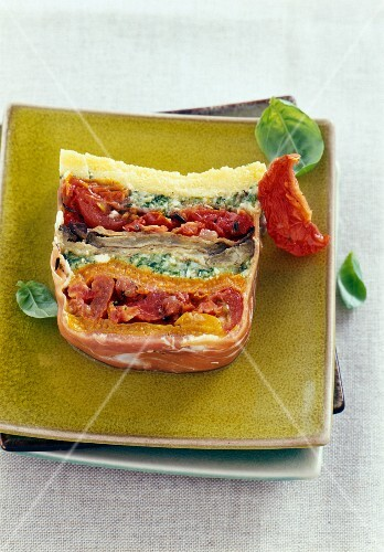 A layered terrine with pickled vegetables and Italian ham