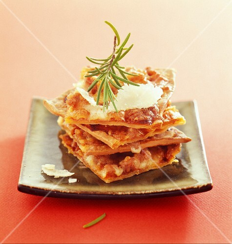 A pizza layer cake with sausages and rosemary