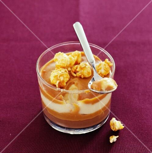 A caramel and popcorn dessert in a glass