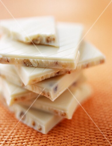 A stack of white, whole nut chocolate