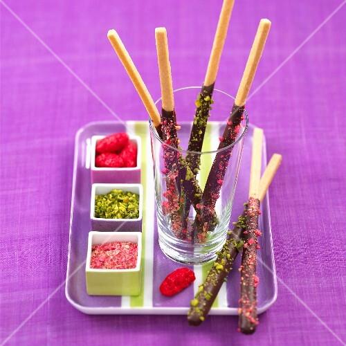 Mikado chocolate sticks with coloured sprinkles