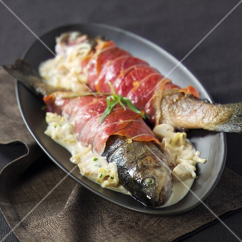 Trout wrapped in bacon with mayonnaise