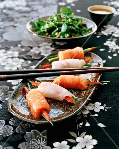 Sashimi rolls made from salmon and branzini with julienned vegetables