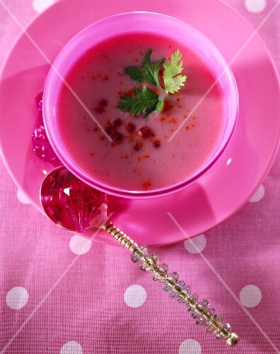 Cream of cauliflower soup with pink pepper