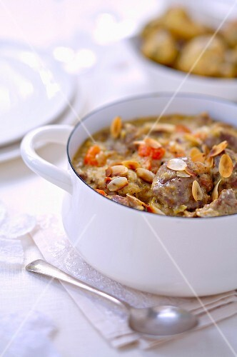 Beef stew with coconut milk and sliced almonds