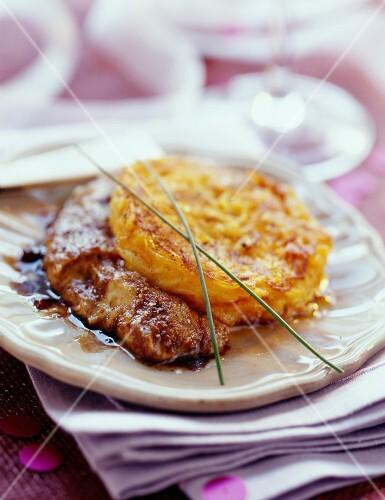 Potato Rôsti on pan-fried foie gras with spices