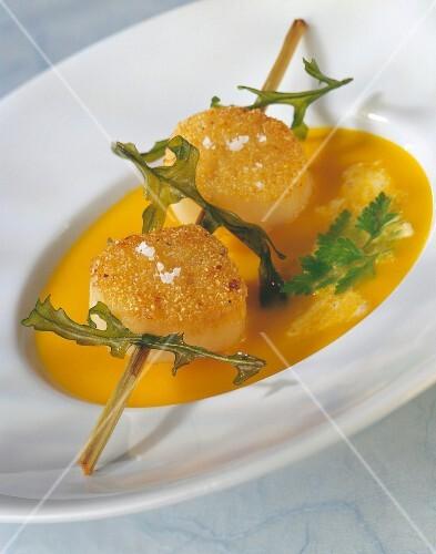 Pumpkin soup with scallop brochette