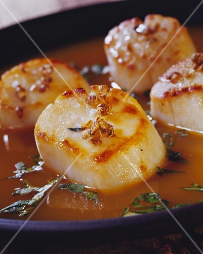 Roasted scallops in carrot and cilantro gravy