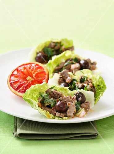Meat salad on cos lettuce with an orange vinaigrette