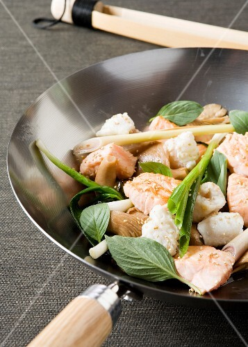 Stir-fried salmon and cod with lemongrass and basil