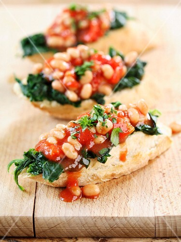 Baked beans and spinach on toast