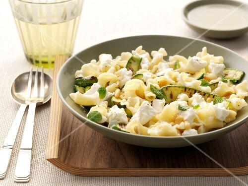 Pasta with pan-fried zucchinis,pine kernels and cheese