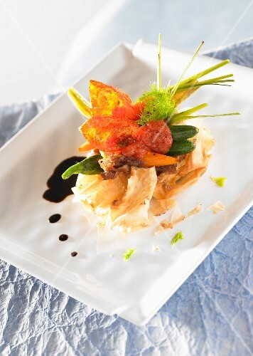 A puff pastry crown with spring vegetables