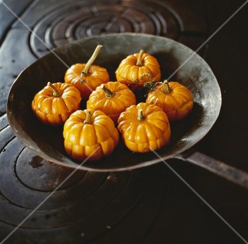 Mini pumpkins in a pan