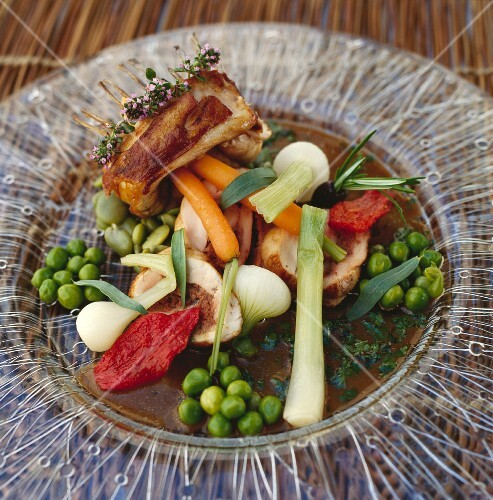 Mini rack of lamb with young vegetables